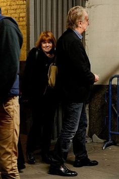 November 2011 -- Alan Rickman and Rima Horton at the stage door of the Golden Theater. No specific date was given.