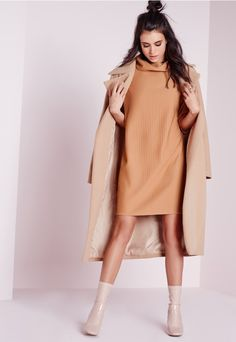 Say no to your boyfriend's oversized sweater this season. Instead, play up your comfy side and lust over this Kourtney Kardashian inspired jumper dress. With an oversized fit, roll neck, and rib style, team with thigh high boots and a cross...