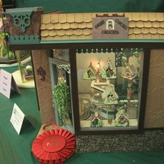 """Photos of Dolls House Scale Homes and Gardens From the Seattle Dollhouse Show: """"Sweet Ginger Delights"""" gingerbread bakery exhibited by Monine Cole at the Fall 2010 Seattle Dollhouse Miniature Show."""