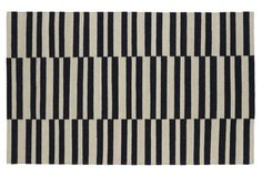 Anna Flat-Weave Rug, Black and White Alternating Stripe -- A striped pattern in black and white hues makes this rug playful and inviting. Handmade from plush wool. A rug pad is recommended to keep this securely in place.