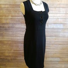 "Banana Republic black cotton knit dress Beautiful. Silver and black buttons. Thin knit cotton. Ultra flattering neckline and overall fit. NWT!   15"" armpit to armpit. 14"" waist. 33.5"" length. Banana Republic Dresses"