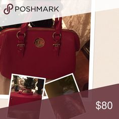 Red Michael Korrs handbag . Beautiful MK red hand bag. Just in time for the holiday. Used X1. Clean inside /out. Great for the festive season. Measurements=9.50x13 inches. Knock off. Got it as a gift . MK Bags
