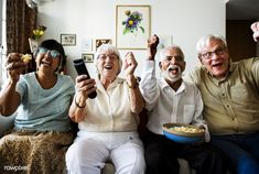 Group of cheerful senior friends sitting and watching TV together Books To Read For Women, Sleeping Alone, Old Person, Indian Man, Woman Reading, People Talk, How To Take Photos, Drinking Tea, High Quality Images
