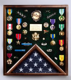 Going to try and do something along this idea for all of the boys (or most of) his hockey medals. Minus the flag part. Flag Display Case, Coin Display, Military Retirement Parties, Retirement Gifts, Army Medals, Military Shadow Box, Military Crafts, Military Awards, Award Display