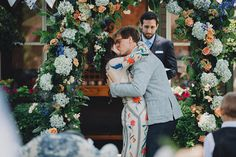 So many things about this wedding!!!!!!  newlyweds kiss - photo by Braun Photography http://ruffledblog.com/bohemian-wedding-with-a-colorful-patterned-dress