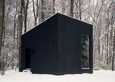 This tiny black cabin by US firm Studio Padron serves as a cosy library and guest house for a vacation home in upstate New York