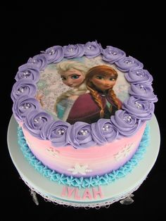 Elsa and Anna edible image on a buttercream covered chocolate mud cake.