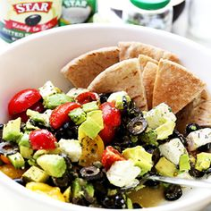 A delicious, colorful and summery avocado salad with STAR Pitted Ripe Olives without Liquid, tomatoes and feta cheese. #STARFineFoods