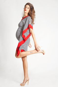 A symetric dress by LaRobeBleue on Etsy, $150.00. I wish I had looked like that pregnant!