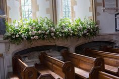 Giant spring bouquets were lined in the windowsills and helped add a pretty English garden feel to the picturesque chapel.