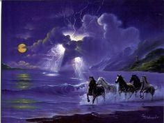 Cavalli che corrono sulla riva della spiaggia