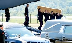 Bodies of MH17 victims arrive back in the Netherlands