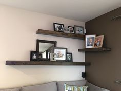 DIY rustic floating corner shelves -perfect for above the couch. The alternating wall look adds dimension to a small room