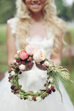 A blackberry and pale peach rose flower crown for a natural autumn bride