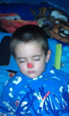 December 10, 2011 Stanley painted Eli's nose to look like Rudolph while he was sleeping :)