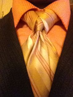 The Merovingian, like the character from The Matrix. A little more complex and quite stylish. Truly should be worn with a vest. A nice knot for a conversation piece.