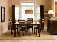 rectangular dining room table in a square room