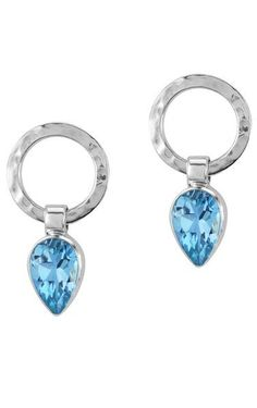 Blue Topaz Silver Earrings. The sky-blue stones have a princess-y feel about them and the hammered silver earrings are the perfect sophisticated complement. How does it feel to have all eyes on you?
