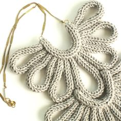 Double Eagle Necklace, hand-knitted - Pale Grey. Done singly, these would be beautiful closures on a sweater.