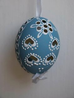 These are real Hens eggs, decorated by hand by artisans from the Moravian region of the Czech Republic. Hand decorated eggs are part of a rich tradition of decorating eggs that spreads throughout the Eastern Europe. This particular style is called the pin drop method, using wax and dye. A small drill is used to create the lace-like patterning of the egg shell.