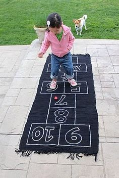 hopscotch rug - check.  I just made one of these today for G.  Its really cute.  I couldn't find a floor runner I liked, so I sewed a couple old towels together to make the length I wanted.  We chalked 12x12in squares and painted the lines.  I used stencils for the numbers.  G can't wait to try it out!