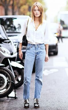 Try tucking a textured button-down shirt into a pair of vintage jeans for a simple yet charming look. via Who What Wear