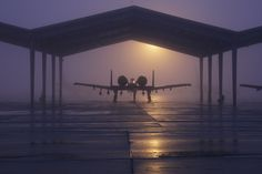 An A-10 Thunderbolt II from the 127th Wing is parked beneath a shelter on a foggy morning [1.800px  1.200px]
