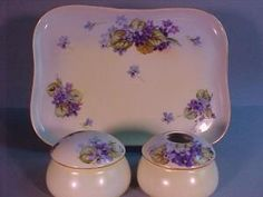 """This is a beautiful hand painted three piece porcelain dresser set consisting of two round boxes and a dresser tray: the tray measures 11"""" x 8"""" and is Limoges: Klingenberg Mark 7, c. 1890's-1910; the trinket box and hair receiver are stamped Bavaria and initialed D.K. on the tops. The tray is also signed D. Kirchner on back."""