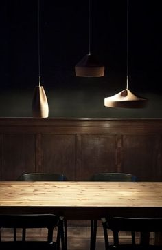 white lights, dark wood, black chairs, and green walls. Who would've thought this would work so well?