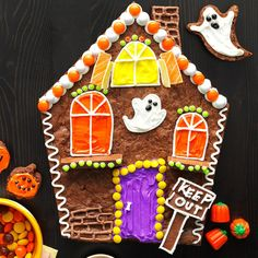 Brownie Haunted House Recipe -You don't have to worry about getting this spooky showstopper to stand upright. These fudgy brownies are the perfect canvas for creating a silly haunted house. Trick-or-treaters beware! —Sarah Thompson, Greenfield, Wisconsin