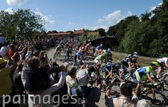 The peloton pass over the bridge in West Tanfield, North Yorkshire