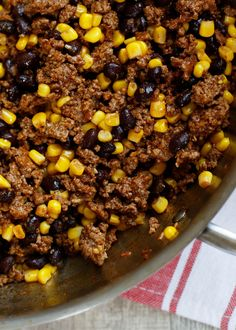 """The BEST Taco Meat starts with ground beef seasoned generously with Mexican spices is tossed with black beans and corn to create a versatile """"taco meat"""" that is perfect for tacos, salads, burritos, quesadillas, and nachos."""