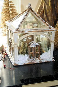 small greenhouse with mini snow scene inside