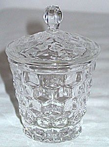 This is a cute little Elegant Glass jam pot with cover in the American pattern made by Fostoria. It stands 4.5 inches tall. It is in good condition with no chips or cracks.
