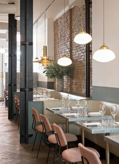 Beautiful London restaurant with exposed brickwork and brass pendant lighting - Frenchie restaurant, Covent Garden London. Designed by Emilie Bonaventure for chef Gregory Marchand. Designs featuring on design blog: www.martynwhitedesigns.com
