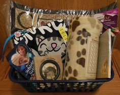 Basket for you and your cat to enjoy!  Includes door mat, pawprint throw, Soft Kitty T-Shirt, cat treats, cat toys and cat collar.