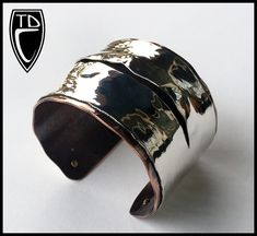 """Todd Conover, Mixed Metal """"Torn"""" Cuff, 2014, copper, sterling, brass"""
