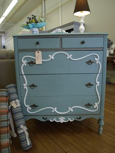 Chalk Paint ® decorative paint by Annie Sloan was used to paint and transform this antique dresser. Colors: Provence with Pure White on the detailing and bronze gilding. By Studio 184