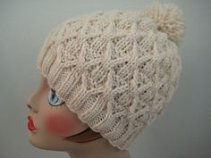 """This fun hat uses twisted stitches to create a lot of textural interest. To knit it, you'll need about 150 yards of worsted weight yarn, a 16"""" circular needle in size 5, one in size 8, and a set of double pointed needles, also in size 8."""