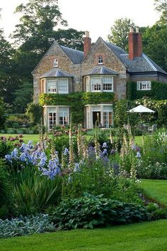 Old Rectory, Northamptonshire, by Clive Nichols. - iris far out front of house idea -