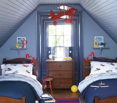 Like Preston's room except one bed. The P on the shelf and the aviation theme fit. Except he's 17 not 7. Dark wood. Blue comforter. I think the roof pitch is less steep. He hits his head on the dormer ceiling at least once.
