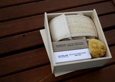 Great gift set with two OLIVELAB NATURALS soaps, sea sponge and loofah belt in a wooden box