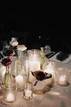 texas wedding; winter wedding; james moes; driskill hotel; black tie reception; moody winter reception; romantic winter reception; long table; crossback bentwood chairs; candelit reception; table garland; roses and ferns garland; fern placeholders;