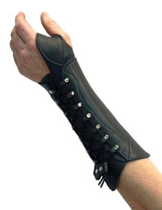 "Bracer for my left arm to protect from ""string slap""."