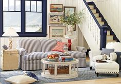 love this off center arrangement of the couch and with window balanced by the paintings!