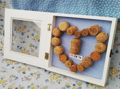 Make this easy DIY crafts handmade heart shaped engagement champagne cork frame! The perfect memory to celebrate getting engaged before your wedding or to give as a gift!
