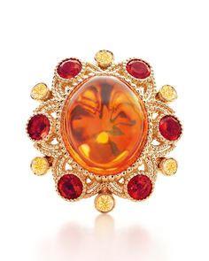 Tiffany & Co - BlueBook Collection ring with a 10.54ct cabochon fire opal, yellow diamonds and smaller faceted fire opals.