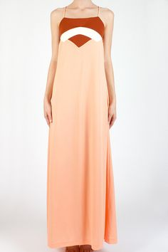 you can buy this! 70s maxi // love the colors and shapes. via they roared vintage