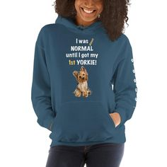 A new hoodie for women Yorkshire Terrier mom and parent from our collection, Almost normal, with white paw prints on the left sleeve.