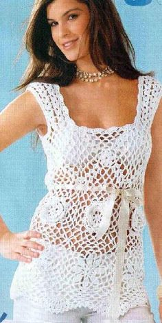 White sleeveless tunic with empire waistline  - has graphs